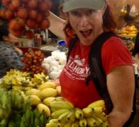 Fresh in season local produce is one of the best ways to stay nourished and hydrated on tour. Mandy having a great time shopping in the Siem Reap markets