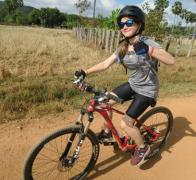 Hazel gives the thumbs up to biking in Cambodia
