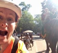 Mandy in the passing lane cycling in Cambodia