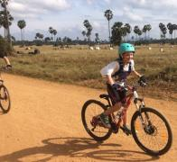 Mark in pursuit of Zoes hot line biking in Cambodia