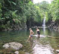 Cooling off in a stunning waterfall. Taveuni Island Fiji