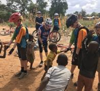 High fives and smiles are an international language. Cycling in Kenya Tanzania