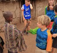 Meeting new friends in Kenya. High fives and smiles are an international language.