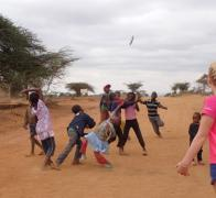 The road is a great place to play frisbee in Kenya