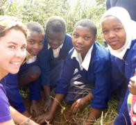 We take the time to plant trees with the local kids