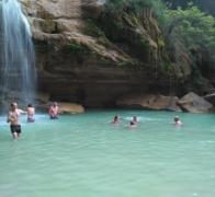 Blissful cooling off under the waterfall in Madagascar