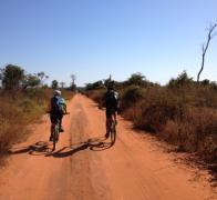 Sarah and Rick biking the busy back roads of Madagascar