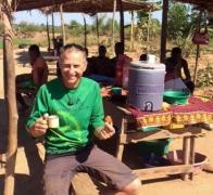 Who can resist roadside coffee and donuts in Madagascar Not John.